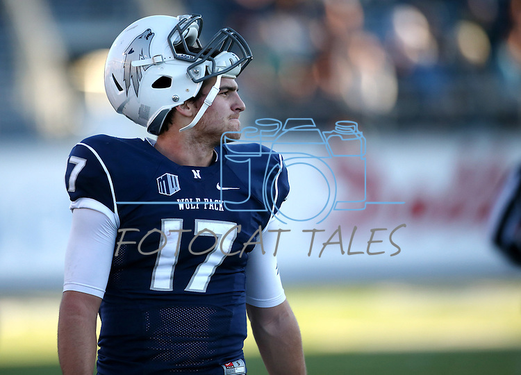 Nevada quarterback Cody Fajardo watches an NCAA college football game against BYU, in Reno, Nev., on Saturday, Nov. 30, 2013. (AP Photo/Cathleen Allison)
