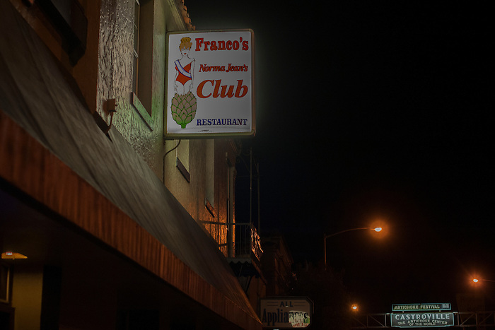 A small, neon sign is all that advertises Franco's Norma Jean's Nightclub in Castroville, Calif.