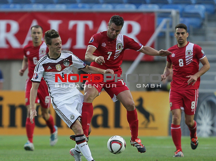 EM 2015 Qualifikationsspiel, Gibraltar vs. Deutschland<br /> Patrick Herrmann (Deutschland), Lee Casciaro (Gibraltar)<br /> <br /> <br /> Foto &copy; nordphoto /  Bratic