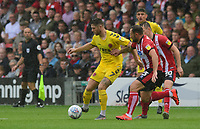 Fleetwood Town's Wes Burns vies for possession with Lincoln City's Neal Eardley<br /> <br /> Photographer Chris Vaughan/CameraSport<br /> <br /> The EFL Sky Bet League One - Lincoln City v Fleetwood Town - Saturday 31st August 2019 - Sincil Bank - Lincoln<br /> <br /> World Copyright © 2019 CameraSport. All rights reserved. 43 Linden Ave. Countesthorpe. Leicester. England. LE8 5PG - Tel: +44 (0) 116 277 4147 - admin@camerasport.com - www.camerasport.com