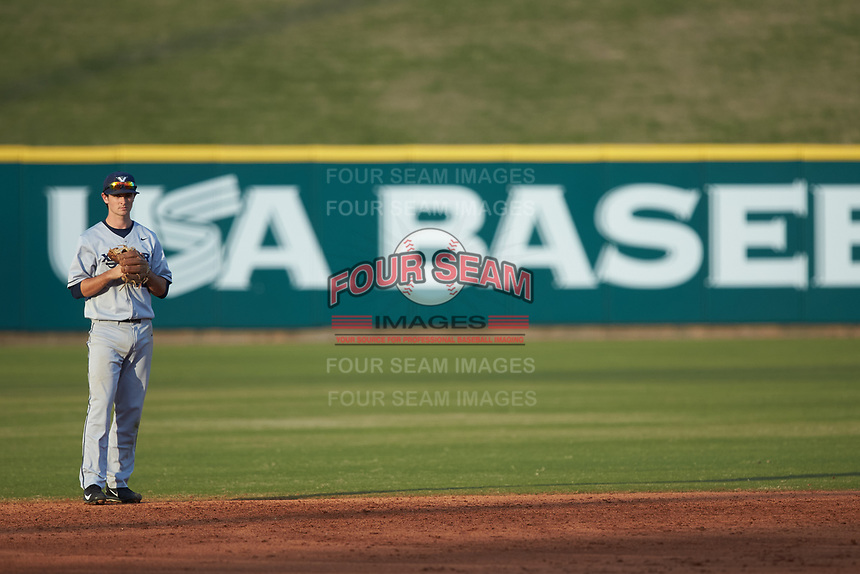 Xavier Musketeers shortstop Mitch Gallagher (12) on defense against the Penn State Nittany Lions at Coleman Field at the USA Baseball National Training Center on February 25, 2017 in Cary, North Carolina. The Musketeers defeated the Nittany Lions 7-5 in game two of a double header. (Brian Westerholt/Four Seam Images)