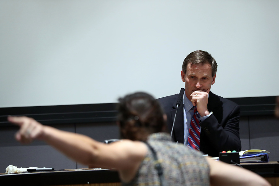 Protestors speak their minds to Mayor Mike Signer during the Charlottesville City Council meeting Monday night in Charlottesville, Va. Photo/Andrew Shurtleff/The Daily Progress