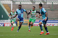 Anthony Stewart of Wycombe Wanderers gets past Tahvon Campbell of Yeovil Town during the Sky Bet League 2 match between Yeovil Town and Wycombe Wanderers at Huish Park, Yeovil, England on 8 October 2016. Photo by Mark  Hawkins / PRiME Media Images.
