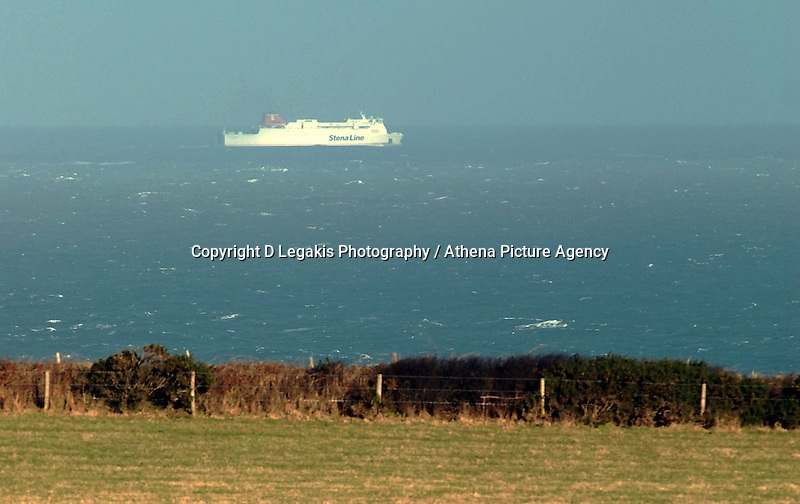 "Pictured: A Stena Lines ferry en route to Rosslare in Ireland as seen off the west Wales coast. STOCK PICTURE<br /> Re: A ferry is back in port in Wales after its passengers and crew spent the night stranded in the Irish Sea.<br /> The Stena Line ferry between Rosslare and Fishguard in Pembrokeshire was unable to dock on Monday with 87 passengers and 59 crew stuck onboard.<br /> It was forced to sail to sheltered waters off the Llyn Peninsula in north Wales overnight and eventually docked nearly 24 hours later than planned.<br /> It follows flooding across Wales in the wake of Storm Angus.<br /> Diane Poole from the ferry operator said passengers had been in ""really good spirits"" despite their night at sea.<br /> ""The ship was well sheltered, they had a comfortable evening and they were well looked after, and they are in very good form this morning,"" she said."