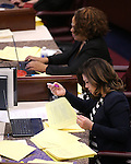 Nevada Assembly Democrats Dina Neal, top, and Teresa Benitez Thompson work on the Assembly floor at the Legislative Building in Carson City, Nev., on Friday, April 3, 2015. <br /> Photo by Cathleen Allison