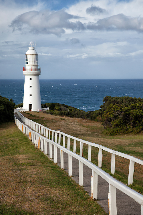 The lighthouse at Cape Otway presides over a surf battered coastline  on the Great Ocean Road.