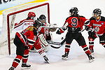 19 MAR 2016: The Division lll Women's Ice Hockey Championship is held at the Ronald B. Stafford Ice Arena in Plattsburgh, NY. Plattsburgh defeated Wis.-River Falls 5-1 for the national title. Four Wis.-River Falls players juggle the puck to keep it out of the net. Nancie Battaglia/NCAA Photos