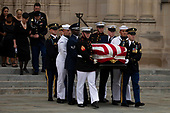 A Military Honor Guard carries the casket of late Senator John McCain, Republican of Arizona, followed by his family after a funeral service at the National Cathedral in Washington, DC on September 1, 2018. Credit: Alex Edelman / CNP