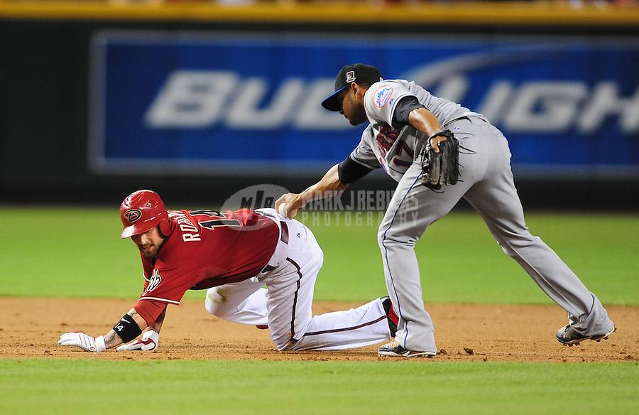 Aug. 11, 2009; Phoenix, AZ, USA; Arizona Diamondbacks base runner Ryan Roberts (14) is tagged out by New York Mets third baseman Fernando Tatis (17) during a seventh inning run down at Chase Field. Mandatory Credit: Mark J. Rebilas-