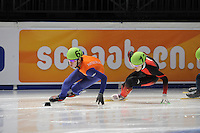 SCHAATSEN: DORDRECHT: Sportboulevard, Korean Air ISU World Cup Finale, 10-02-2012, Sjinkie Knegt NED (62), Quiwen Gong CHN (12), ©foto: Martin de Jong