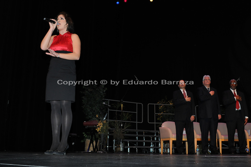 Raven Woessner sings the National Anthem during the inauguration ceremony for new Mayor Greg Stanton and newly-elected and reelected city council members. Photo by Eduardo Barraza © 2012