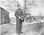 Portrait of Ruben O. Montoya, the photographer's son, standing beside the D&amp;RGW track in Santa Fe.<br /> D&amp;RGW  Santa Fe, NM  Taken by Montoya, Dolores Ortiz - 1940-1949