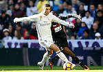 Real Madrid's Cristiano Ronaldo (l) and Granada CF's Uche Agbo during La Liga match. January 7,2016. (ALTERPHOTOS/Acero)