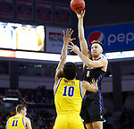 SIOUX FALLS, SD - MARCH 7: IPFW Mastodons forward Dylan Carl #11 goes up for a jump shot against South Dakota State Jackrabbits forward Alou Dillon #10 at the 2020 Summit League Basketball Championship in Sioux Falls, SD. (Photo by Richard Carlson/Inertia)