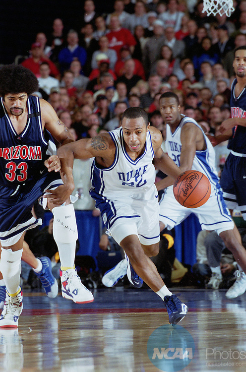 02 APR 2001:  Duke guard Jason Williams (22) drives down court with University of Arizona forward Eugene Edgerson (33) behind during the NCAA Men's Basketball Final Four Championship game held in Minneaplois, MN at the Hubert H. Humphrey Metrodome. Duke defeated Arizona 82-72 for the championship. Rich Clarkson/NCAA Photos