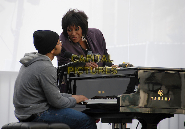 PATTI LABELLE & JOHN LEGEND.doing their soundcheck before the Tiffany & Co. celebration for the launch of Frank Gehry?s premier collection held at Tiffany & Co. on Rodeo in Beverly Hills, California, USA, March 26th 2006..half length piano on stage in concert music gig .Ref: DVS.www.capitalpictures.com.sales@capitalpictures.com.©Debbie Van Story/Capital Pictures