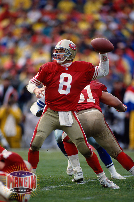 SAN FRANCISCO, CA:  Quarterback Steve Young of the San Francisco 49ers throws a pass during the NFC Championship game against the Dallas Cowboys at Candlestick Park in San Francisco, California on January 17, 1993. (Photo by Brad Mangin)