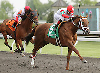 Lonesome Street and Joel Roasrio win the 26th running of the Commonwealth GR2 $175,000 for trainer Michael Maker and owner Ken and Sarah Ramsey.  April 14, 2012.