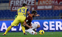Calcio, Serie A: Roma vs ChievoVerona. Roma, stadio Olimpico, 31 ottobre 2013.<br /> ChievoVerona forward Alberto Paloschi, left, and AS Roma midfielder Daniele De Rossi fight for the ball during the Italian Serie A football match between AS Roma and ChievoVerona at Rome's Olympic stadium, 31 October 2013.<br /> UPDATE IMAGES PRESS/Isabella Bonotto