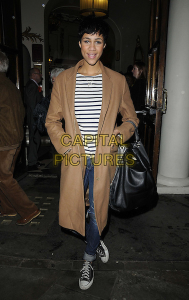 Zawe Ashton.The 'Spamalot' press night, Playhouse Theatre, Northumberland Avenue, London, England..November 20th, 2012.full length  beige leather long coat hands in pockets white blue stripe top nautical black bag purse .CAP/CAN.©Can Nguyen/Capital Pictures.