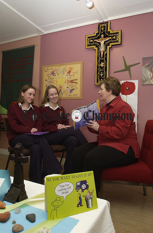 Leaving Cert Students Lorraine Treacy and Deirdre Moloney, with teacher Geraldine Condren, at work on the Information Support Programme For Parents, in Scarriff Community College. Photograph by John Kelly.