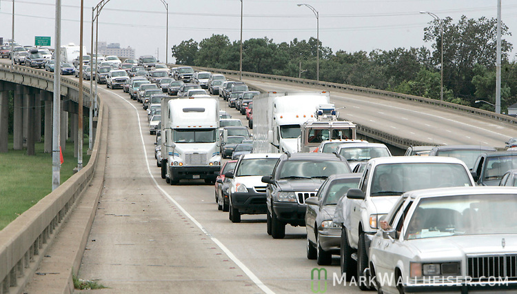 Traffic streams out of New Orleans on Interstate 10 with no traffic headed inbound on Sunday August 28, 2005 as part of the manatory evacuation because of Hurricane Katrina.