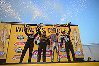 Jul. 1, 2012; Joliet, IL, USA: NHRA (R-L) top fuel dragster driver Antron Brown, funny car driver Jeff Arend, pro stock motorcycle rider Andrew Hines and pro stock driver Erica Enders celebrate after winning the Route 66 Nationals at Route 66 Raceway. Mandatory Credit: Mark J. Rebilas-
