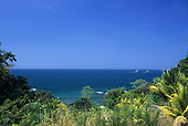 Marino Ballena National Park, Costa Rica. Overview of the coastline with blue sea, rainforest and rocky islands.