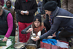 Volunteer Monique Fritsche (centre) and a fellow volunteer serving food as part of the We Picknick group which distributes food to newly-arrived refugees in Berlin. The volunteer initiative was one of many initiated by citizens of the city to help refugees. Around 60,000 refugees arrived in the city in the first 10 months of 2015, out of an overall total of around 850,000 in the whole of Germany.
