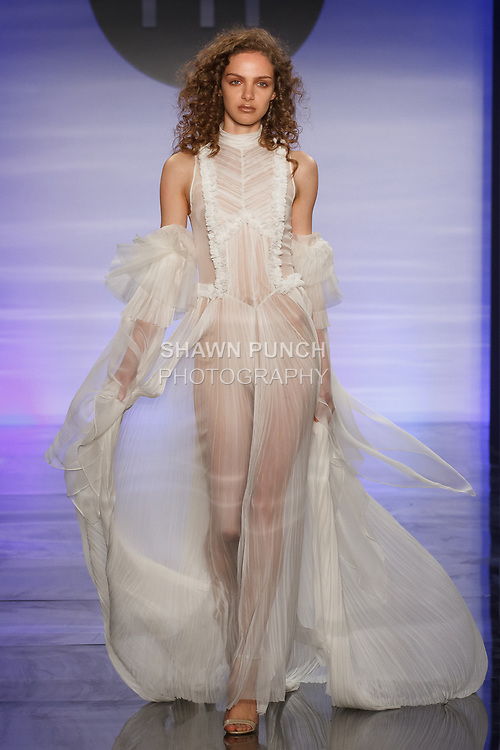 Model walks runway in an outfit by Sandra Nicole Muniz, during the Future of Fashion 2017 runway show at the Fashion Institute of Technology on May 8, 2017.