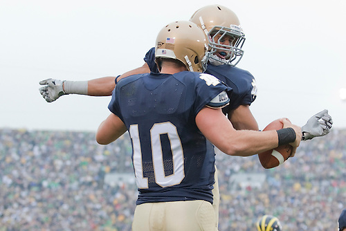 Notre Dame quarterback Dayne Crist (#10) and wide receiver TJ Jones (#7) celebrate play during NCAA football game between the Notre Dame Fighting Irish and the Michigan Wolverines.  Michigan defeated Notre Dame 28-24 in game at Notre Dame Stadium in South Bend, Indiana.