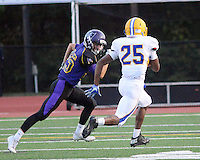 Palisades Matthew McGrath #25 chases after Wilson's Job Goodman in the first quarter at Palisades High School Friday September 2, 2016 in Kintnersville, Pennsylvania.  (Photo by William Thomas Cain)