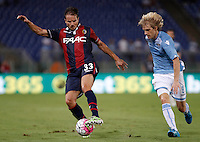 Calcio, Serie A: Lazio vs Bologna. Roma, stadio Olimpico, 22 agosto 2015.<br /> Bologna&rsquo;s Matteo Brighi, left, is chased by Lazio&rsquo;s Dusan Basta during the Italian Serie A football match between Lazio and Bologna at Rome's Olympic stadium, 22 August 2015.<br /> UPDATE IMAGES PRESS/Isabella Bonotto