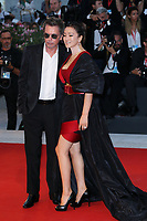 "VENICE, ITALY - SEPTEMBER 04: Jean-Michel Jarre, Gong Li walk the red carpet ahead of the ""Lan Xin Da Ju Yuan"" (Saturday Fiction) screening during the 76th Venice Film Festival at Sala Grande on September 04, 2019 in Venice, Italy. (Photo by Ernesto Ruscio/Insidefoto)<br /> Venezia 04/09/2019"