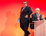 © Joel Goodman - 07973 332324 . 27/09/2016 . Liverpool , UK . TOM WATSON takes to the stage , applauded by JEREMY CORBYN , to deliver the deputy leader's speech on the third day of the Labour Party Conference . Photo credit : Joel Goodman