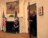 United States President Barack Obama arrives to deliver remarks on the completion of a review and to announce a new policy concerning how the US Government responds to overseas hostage situations in the Roosevelt Room of the White House in Washington, DC on June 24, 2015.  <br /> Credit: Dennis Brack / Pool via CNP