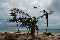 Quintana Roo, Mexico. Friday, August 24, 2007.  A military helicopter flies over Mahahual to survey the damage. The town of Mahahual was where category 5 Hurricane Dean first made landfall in Mexico, with winds of 300km/h it was where most of the damage was suffered.