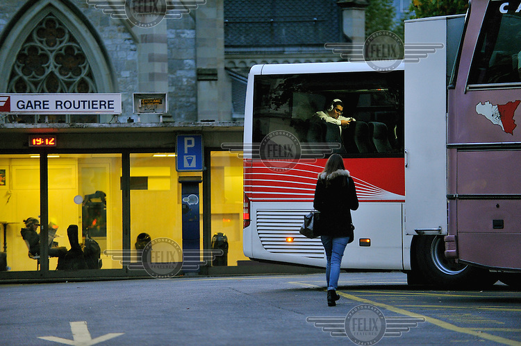 A passenger on a bus leaving for Annecy in France at the International long distance bus station in Geneva (Gare routiere). The service is often used by commuters working in Switzerland, but living in France.