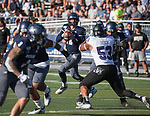 Nevada's Carson Strong (12) looks to pass in the Nevada vs Weber State football game in Reno, Nevada on Saturday, Sept. 14, 2019.