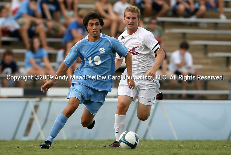 06 September 2009: UNC's Michael Farfan (19) and Evansville's Dan Gibson (behind). The University of North Carolina Tar Heels defeated the Evansville University Purple Aces 4-0 at Fetzer Field in Chapel Hill, North Carolina in an NCAA Division I Men's college soccer game.