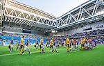 Stockholm 2014-07-07 Fotboll Allsvenskan Djurg&aring;rdens IF - IF Elfsborg :  <br /> Spelare i Djurg&aring;rden och Elfsborg p&aring; v&auml;g ut p&aring; planen inf&ouml;r matchen med Djurg&aring;rdens supportar i bakgrunden<br /> (Foto: Kenta J&ouml;nsson) Nyckelord:  Djurg&aring;rden DIF Tele2 Arena Elfsborg IFE supporter fans publik supporters
