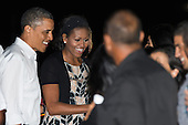 United States President Barack Obama and first lady Michelle Obama greet well wishers before boarding Air Force One for their return flight to Washington at Joint Base Pearl Harbor-Hickam on Saturday January 5, 2013 in Honolulu, Hawaii..Credit: Kent Nishimura / Pool via CNP