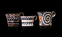 "Minoan Kamares ""eggshell"" ware cups with  with  polychrome decorations, from set found at Phaistos Palace 1800-1600 BC; Heraklion Archaeological  Museum, black background.<br /> <br /> These cups found as parts of sets in Phaistos palace were names ""eggshell"" ware due to the very thin walls of the cups. This style of pottery is named afetr Kamares cave where this style of pottery was first found"
