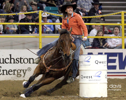 1/24/09--Photo by Rick Davis--WPRA cowgirl Jill Ferdina Miller of Lewistown, Montana turns in a 15.87 second barrel racing run during action at the 103rd National Western Stock Show and Rodeo in Denver, Colorado.