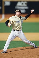 Wake Forest Demon Deacons starting pitcher Max Tishman (34) delivers a pitch to the plate against the Marshall Thundering Herd at Wake Forest Baseball Park on February 17, 2014 in Winston-Salem, North Carolina.  The Demon Deacons defeated the Thundering Herd 4-3.  (Brian Westerholt/Four Seam Images)