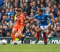 Shrewsbury Town's Alex Gilliead (left) under pressure from Portsmouth's Nathan Thompson (right) <br /> <br /> Photographer David Horton/CameraSport<br /> <br /> The EFL Sky Bet League One - Portsmouth v Shrewsbury Town - Saturday September 8th 2018 - Fratton Park - Portsmouth<br /> <br /> World Copyright &copy; 2018 CameraSport. All rights reserved. 43 Linden Ave. Countesthorpe. Leicester. England. LE8 5PG - Tel: +44 (0) 116 277 4147 - admin@camerasport.com - www.camerasport.com