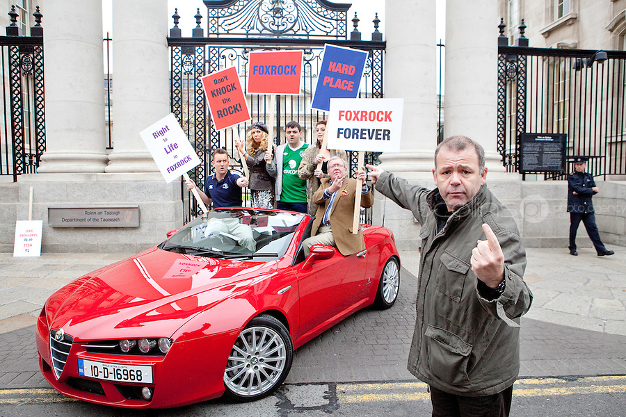 "NO FEE. 14/10/2010. SAVE OUR FOXROCK. The cast of Ross O'Carroll-Kelly play gather to protest outside Government Buildings to protest the recent decision to rezone Foxrock to Sandyford East as their play ""Between Foxrock and a hard place"" gets ready to open. L- R are Aoibhinn McGinnity,, Rory Nolan {Ross O'Carroll-Kelly} and Lisa Lambe.  Picture James Horan/Collins Photos"