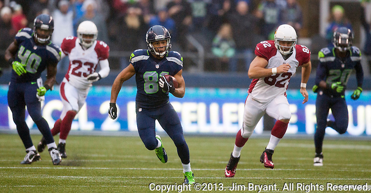 Seattle Seahawks  punt return specialists Golden Tate returns a punt for 29-yards against theArizona Cardinals at CenturyLink Field in Seattle, Washington on December 22, 2013.  The Cardinals beat the Seahawks 17-10.  ©2013. Jim Bryant Photo. ALL RIGHTS RESERVED.