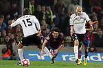 Football Season 2009-2010. Barcelona's player Lionel Messi (C) and Valencia's  Dealbert (L) and Bruno (R) during their spanish liga soccer match between Barcelona vs Valencia at Camp Nou  stadium in Barcelona. 14 March 2010.
