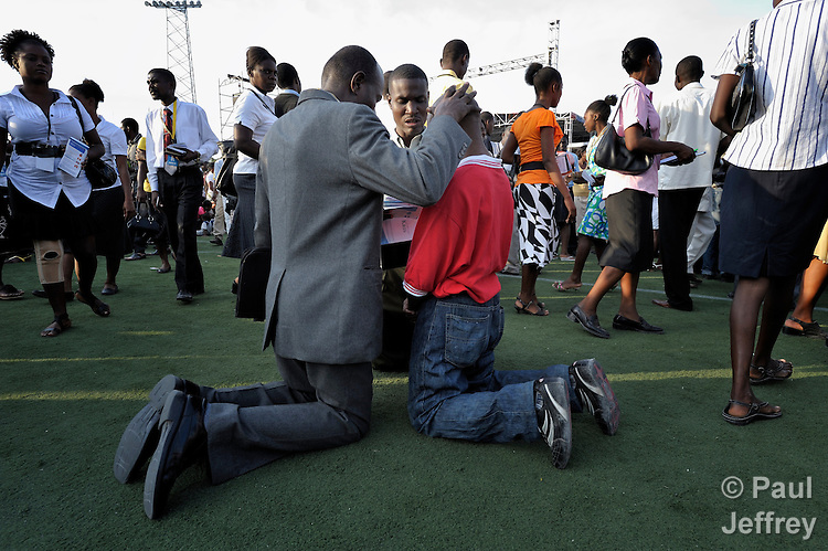Just before the one-year anniversary of the January 2010 earthquake that ravaged Port-au-Prince, Haiti, Franklin Graham, the conservative U.S. evangelical leader, preached to a rally at the national soccer stadium. Afterward, some Haitians came forward for the altar call and volunteers knelt and prayed with them